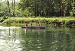 having fun exploring in a canoe while camping